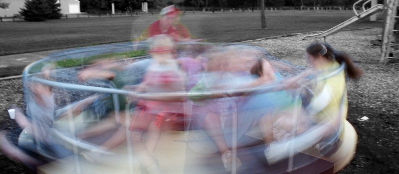 group of children playing on the playground dizzy